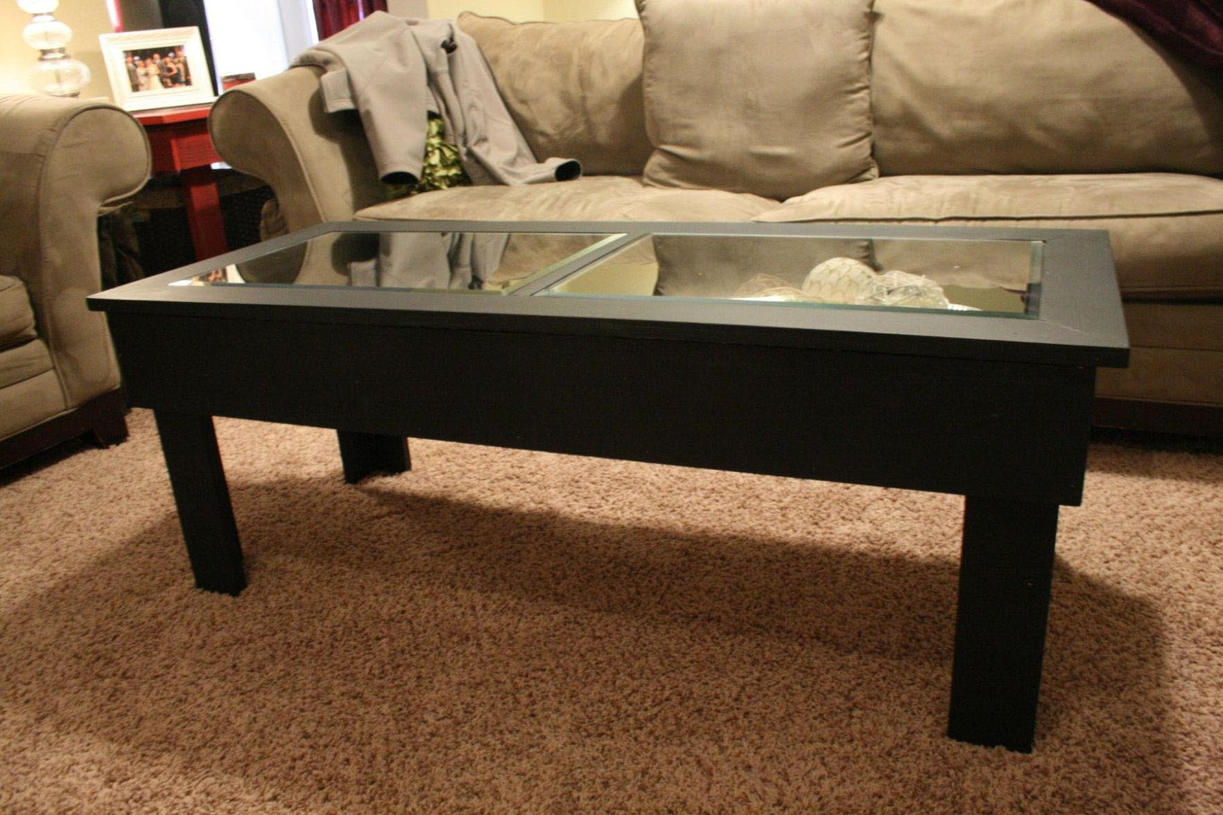 Glass top display coffee table coffee table design ideas for Table top display ideas